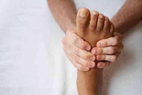 Pure Clinic - One Hour Reflexology or Hot Stone Massage Treatment  - Save 0%
