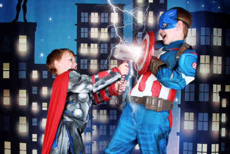 "Wink Photography - Superhero themed childrens photoshoot for up to two including two 10"" x 8"" prints and a goody bag each   - Save 90%"