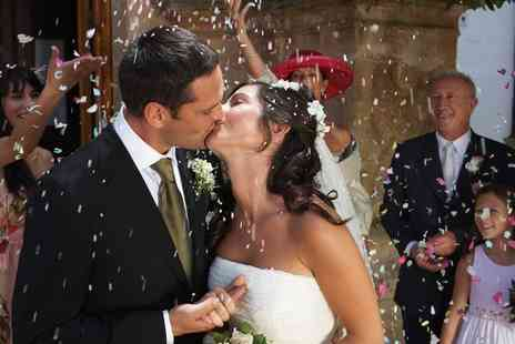 Artistic Motion - Wedding Photo and Video Package with Eight Hours of Coverage - Save 54%