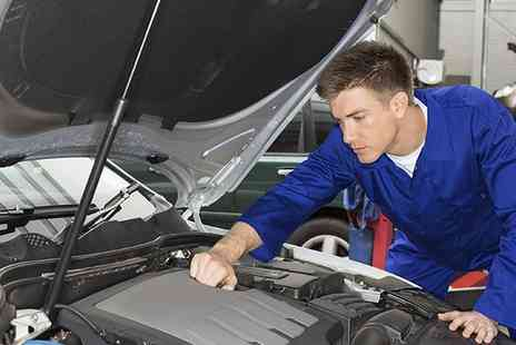 John Saint Automotive - MOT Test, 59 Point Winter Check with Oil and Filter Change or Laser Wheel Alignment - Save 25%