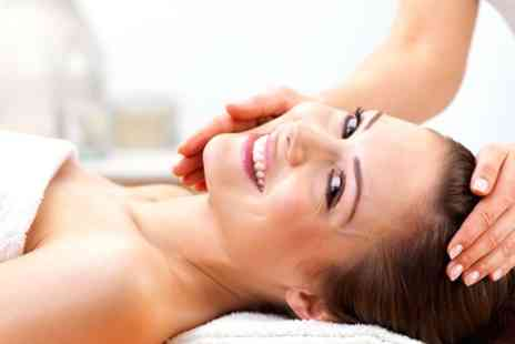 The Beauty Hut - Facial and a Foot and Leg or Hand and Arm Massage - Save 69%
