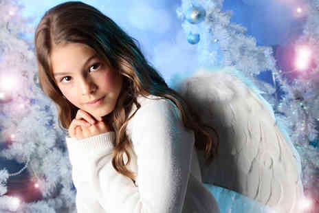 Wink Photography - Snow angel photoshoot for up to four kids including a snow globe and two prints  - Save 87%