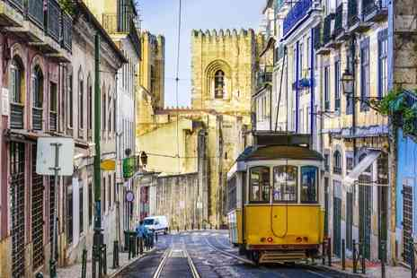 Fly to Porto & Lisbon  - Enjoy Three nights Stay in Lisbon and Two in Porto including flights train and breakfast - Save 0%