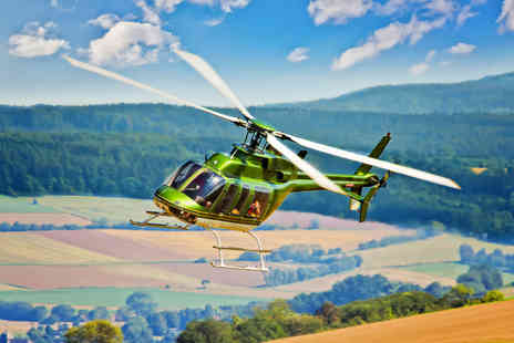 Hields Aviation -  20 minute helicopter tour of Leeds for up to three   - Save 67%