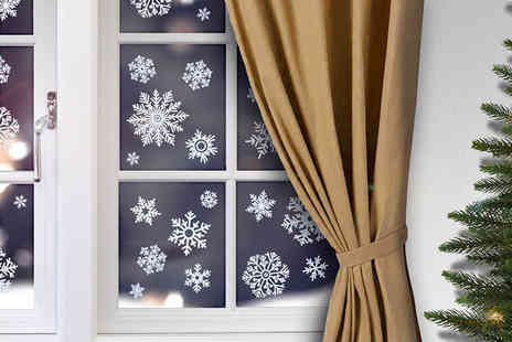 Heads Group - Sheet of Christmas snowflake window stickers - Save 50%