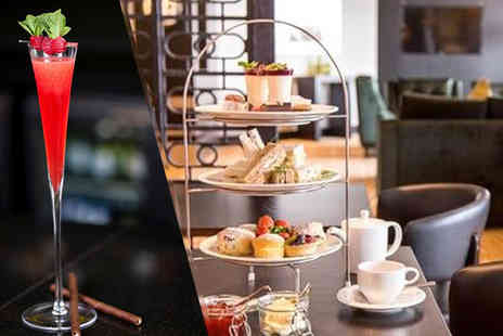 Hilton Canary Wharf - Afternoon tea for two with a Champagne cocktail each  - Save 52%