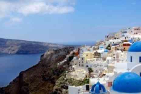 Artemis Suites - In Santorini Four Night Stay For Two With Massage Each, Breakfast, Wine, and Fruit Basket - Save 53%
