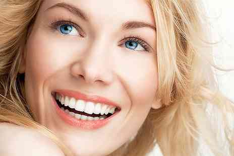 Cheshire Dental Centre - Professional teeth whitening plus a 25 point dental examination  including x rays - Save 0%