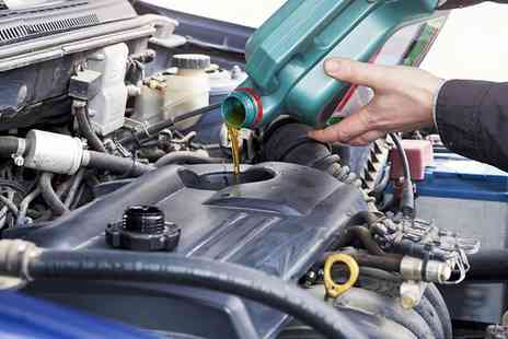 Car Care - Car Service with Oil Change and Fluid Top Ups - Save 51%