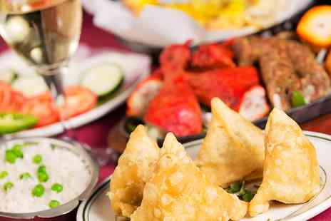Obsession Of India - Two course Indian Meal with Wine for Two or Four - Save 52%