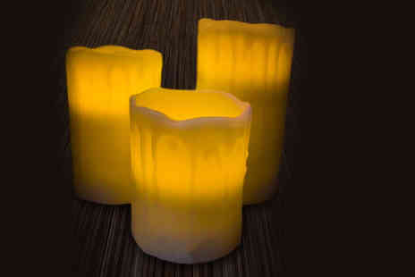UK Home and Garden Store - Set of three flickering drip effect LED candles - Save 76%
