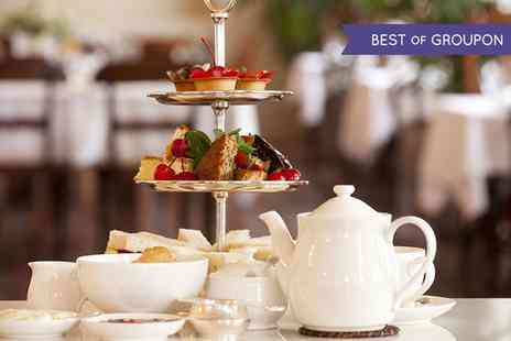The Corinthian Restaurant - Classic or Sparkling Afternoon Tea for Two or Four  - Save 56%