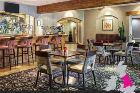 Jurys Inn  - Overnight stay in a double or twin room, including a two course dinner with a bottle of house wine, breakfast, and free parking - Save 47%