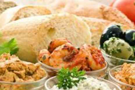 Ambience - Eight hot and cold mezes for four people, with a cocktail pitcher to share - Save 69%