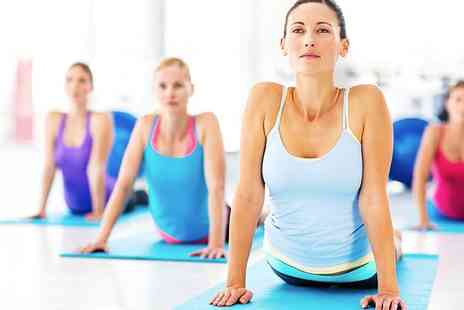 Red Hot Yoga - 10 Class Passes for Weekdays and Weekends for One or Two - Save 74%