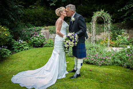 "DH Photography - Six hour wedding photography package including five 10"" x 5"" prints and a USB stick of images - Save 50%"