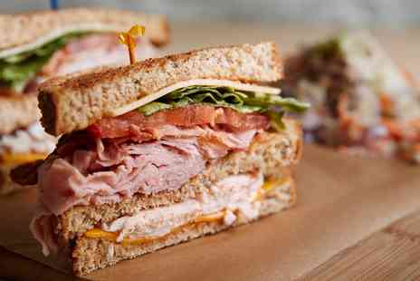 Betty & Flos Cafe - Choice of Sandwiches, Paninis or Wraps with Cake and Hot Drink for Up to Four - Save 0%