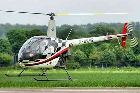 Heli Air - Introductory Helicopter Flying Lesson with Time at Controls with Heli Air, Six Locations - Save 40%