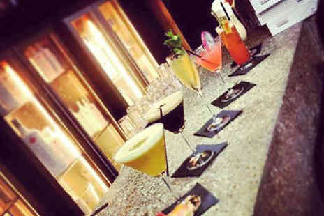 The Hilton Hotel - Four cocktails to share between two - Save 47%