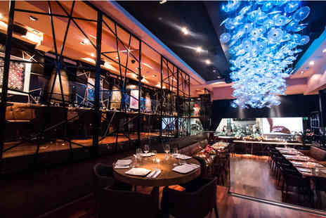 DSTRKT - Four cocktails and nibbles for two include lounge entry - Save 0%
