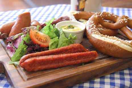 Octoberfest Pub - Snack Platter, Pint of German Beer and Traditional Schnapps for Two or Four - Save 48%