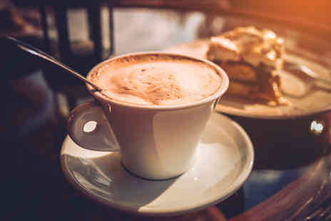 Cocomacs - Belgian hot chocolate or chai latte and a macaroon or uno cake each for two - Save 0%