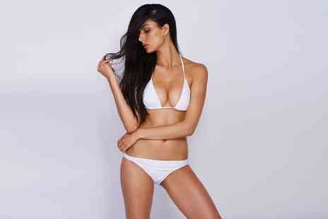 London Beauty and Tanning - Brazilian or Hollywood Wax with Optional Underarm or Lower Leg Wax - Save 0%