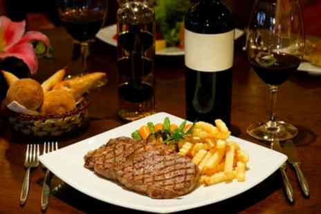 Robertos Restaurant - Steak Meal with Bottle of Wine for Two or Four - Save 50%