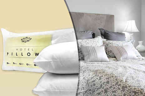 TNS Fabrics -Two hotel quality extra filled pillows or four pillows - Save 75%