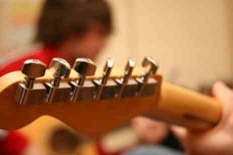 Belfast Music Academy - Four 60 Minute Group Guitar, Keyboard or Vocal Lessons - Save 55%