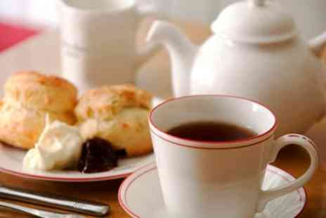 Red Door - Cream Tea for Two or Four - Save 0%
