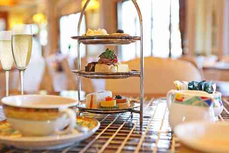 The Biscuit Tin - Festive Afternoon Tea with Prosecco for Two or Four - Save 45%