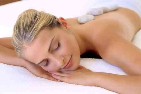 Wild Ginger - 30 or 60 Minute Himalayan Hot Stone Massage - Save 48%