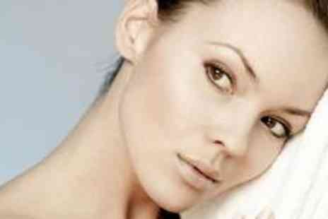 Pure Beauty - Signature facial and a back, neck and shoulder massage - Save 72%
