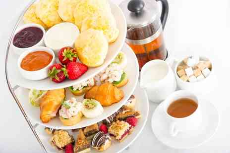 Cappuccinos Grantham - Afternoon Tea for Two or Four - Save 0%
