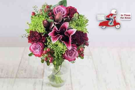 Debenhams Flowers - Christmas bouquet of flowers including roses, lilies and carnations - Save 50%