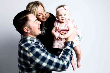 Moda Studios - Family photoshoot for up to eight people including refreshments and five 10 Inch x 8 Inch prints - Save 55%
