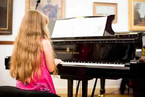 Primo Music - Two piano lessons - Save 64%