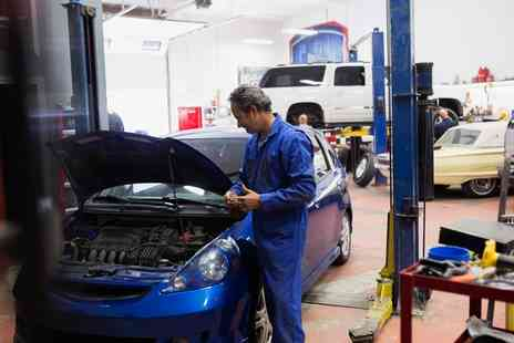Piston And Rotor The Garage - 54 Point Car Service with Oil Change and Optional Engine Diagnostic Test - Save 42%