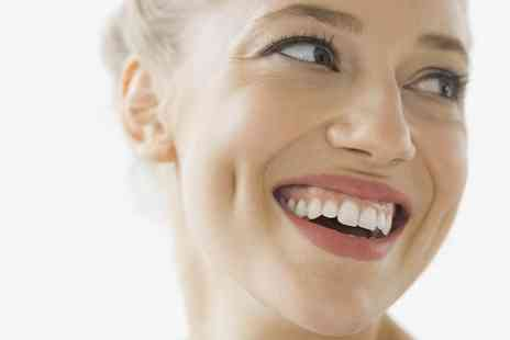 Crystal Smile Dental Care - Dental Exam with Scale and Polish or with Airflow Polish and X Rays - Save 51%