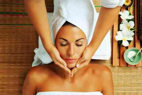 Room Nine - One hour Tropic facial including a heated body wrap and head, hand and arm massage - Save 50%