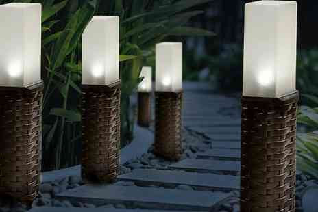 Groupon Goods Global GmbH - Four or Eight Pack of Woven Rattan Effect Post Solar Lights - Save 35%
