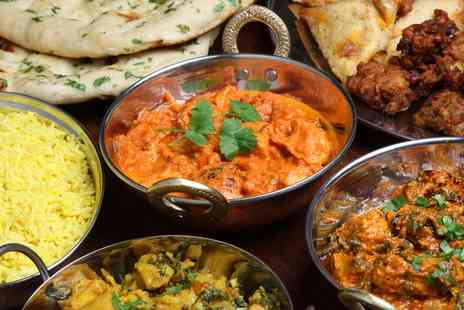 Moti Mahal - Two Course Indian Meal with Naan or Rice and Wine for Two or Four - Save 61%