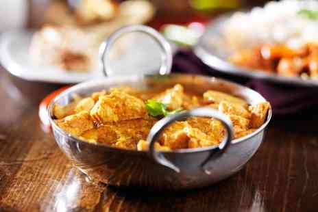 Indali Kitchen - Two course Indian dining for two people with a glass of wine, side and rice dish each - Save 67%