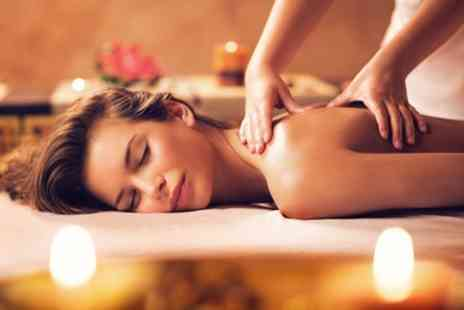 PureSun - One Hour Full Body Swedish or Aromatherapy Massage - Save 50%