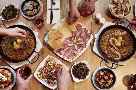 Mas Q Menos - Four Tapas dishes and a bottle of wine for two - Save 45%
