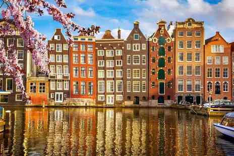 Weekender Breaks - Two or three night 4 Star Amsterdam Spa stay including flights and glass of Prosecco on arrival - Save 40%