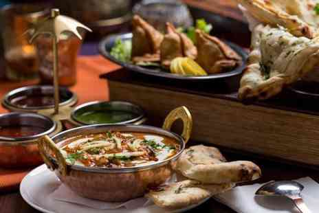Ishys Bar Lounge Grill - Two course Indian dining for two people with a bottle of wine to share - Save 63%