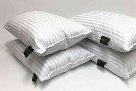 Home Furnishings Company - Four or eight hotel quality striped pillows - Save 80%