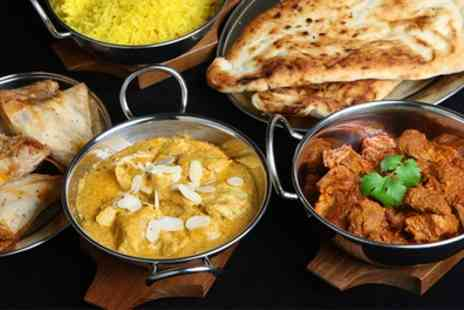 The Tamarind - Three Course Indian Meal with Sides for Two or Four - Save 55%